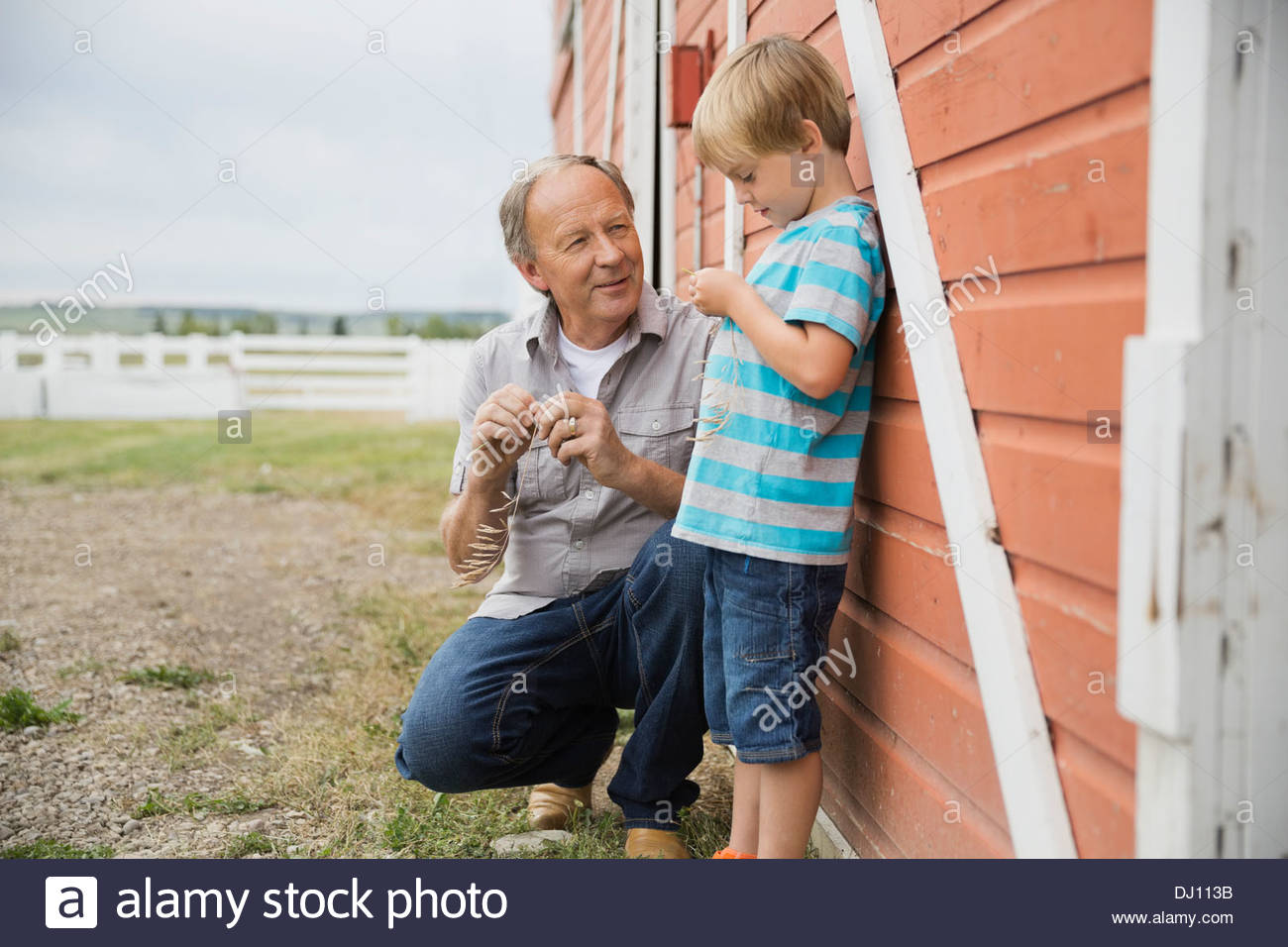Grandfather and grandson spending time together outdoors - Stock Image