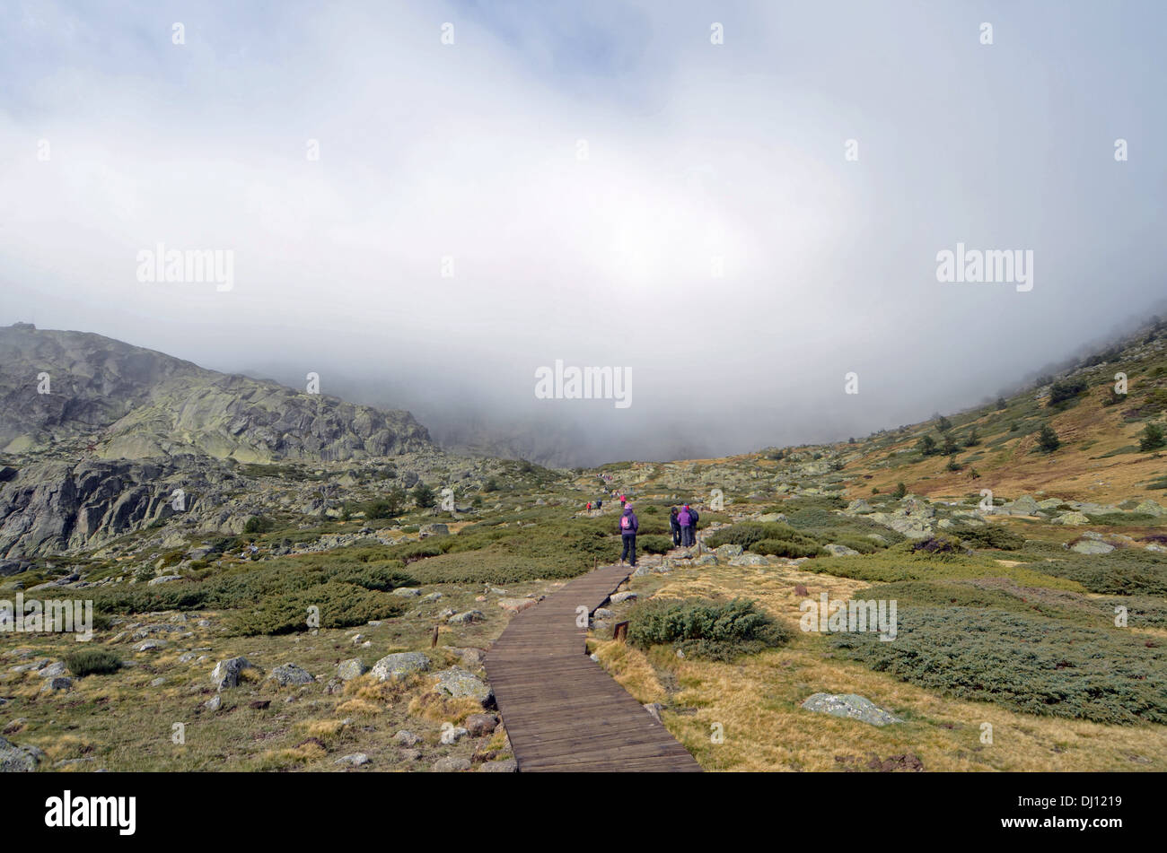 Foggy day in Peñalara, highest mountain peak in the mountain range of Guadarrama, Spain Stock Photo