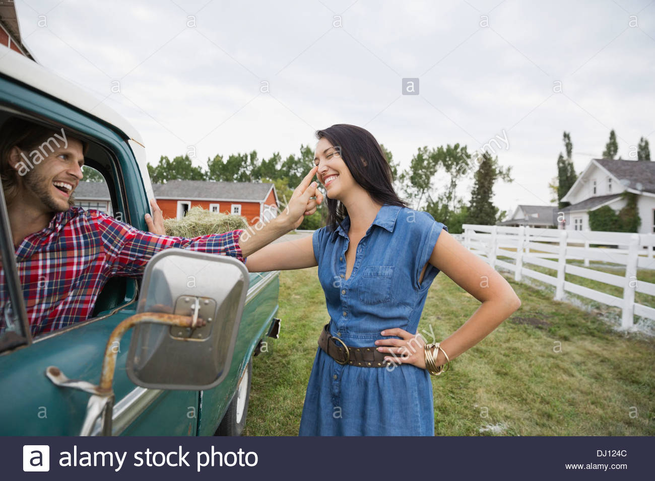 Man giving affectionate good-bye to woman - Stock Image