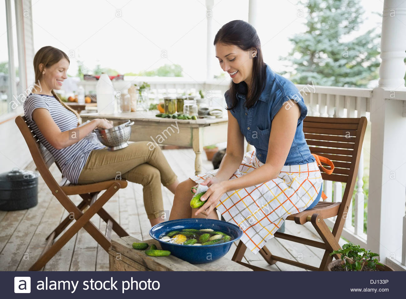 Women washing vegetables for canning - Stock Image