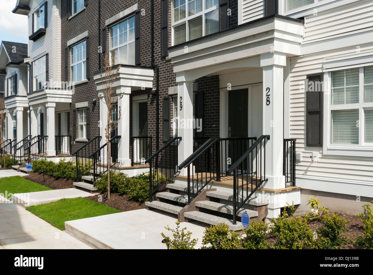 Modern Townhouse Row Exterior With Sidewalks And Porches; Surrey, British  Columbia, Canada
