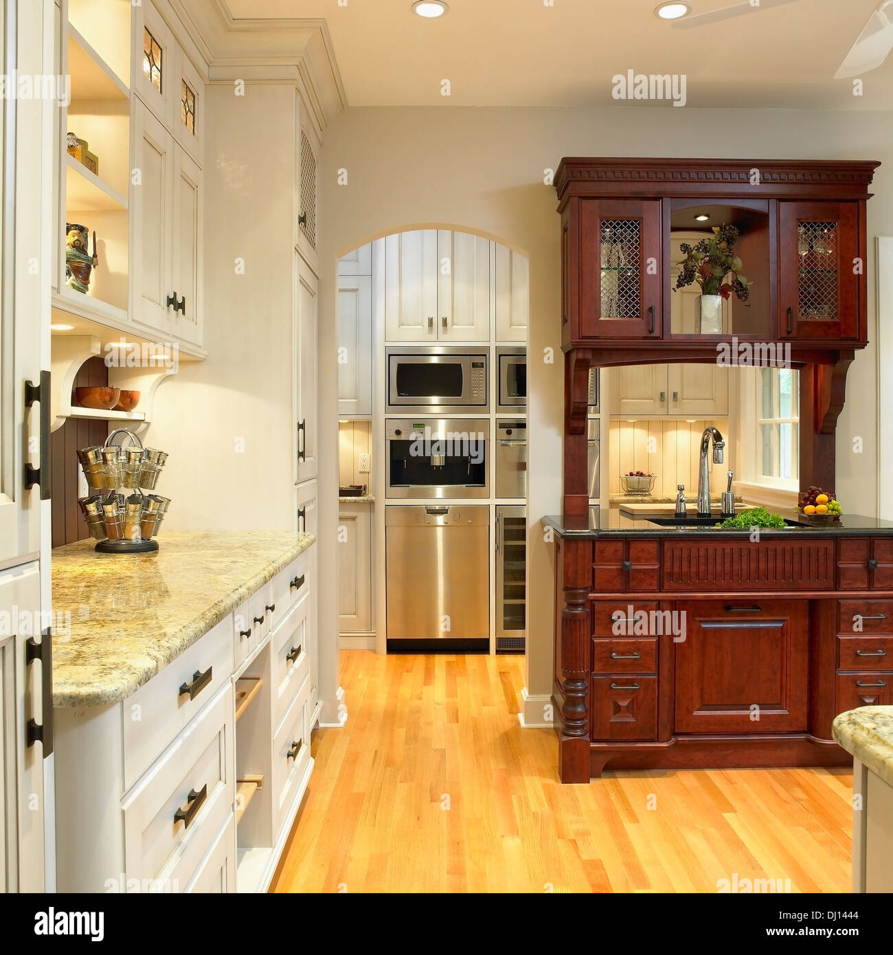 Traditional Kitchen With Cream Cabinets And Built In Dark Wood Hutch Stock Photo Alamy