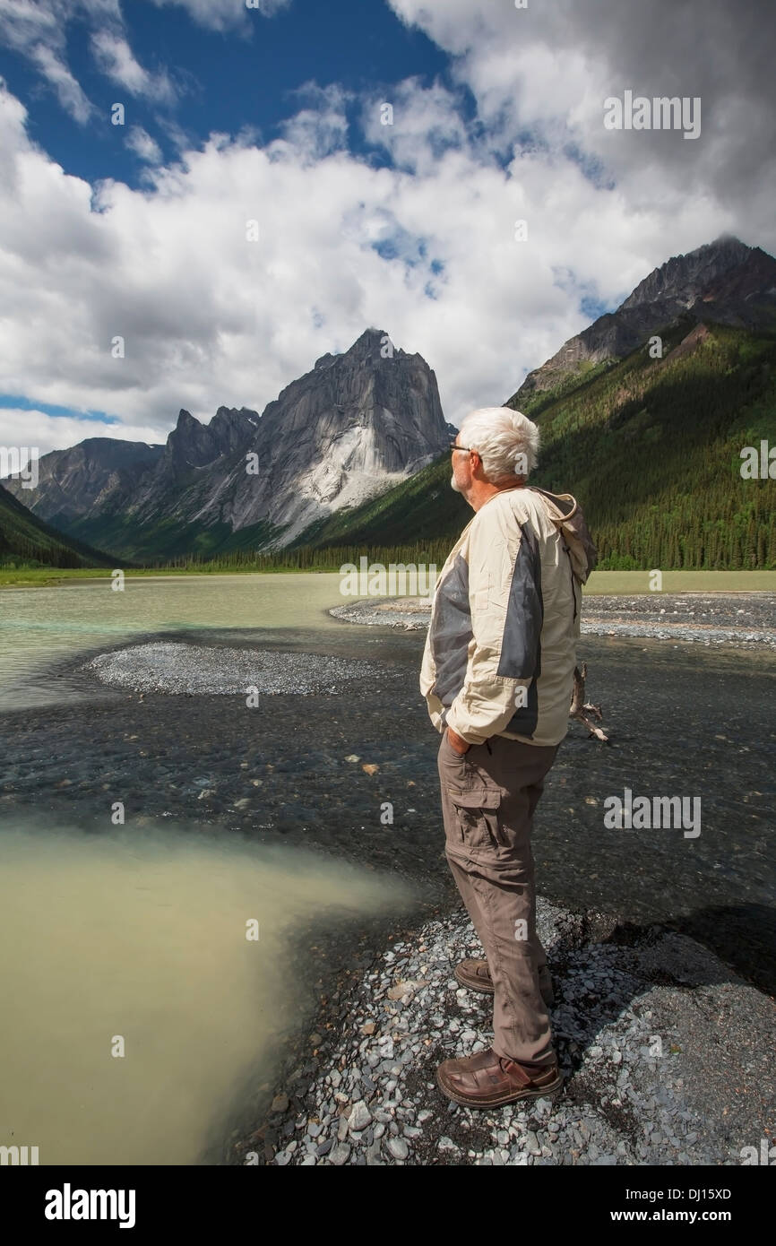 Man Stands On The Shores Of Glacier Lake; Northwest Territories, Canada Stock Photo