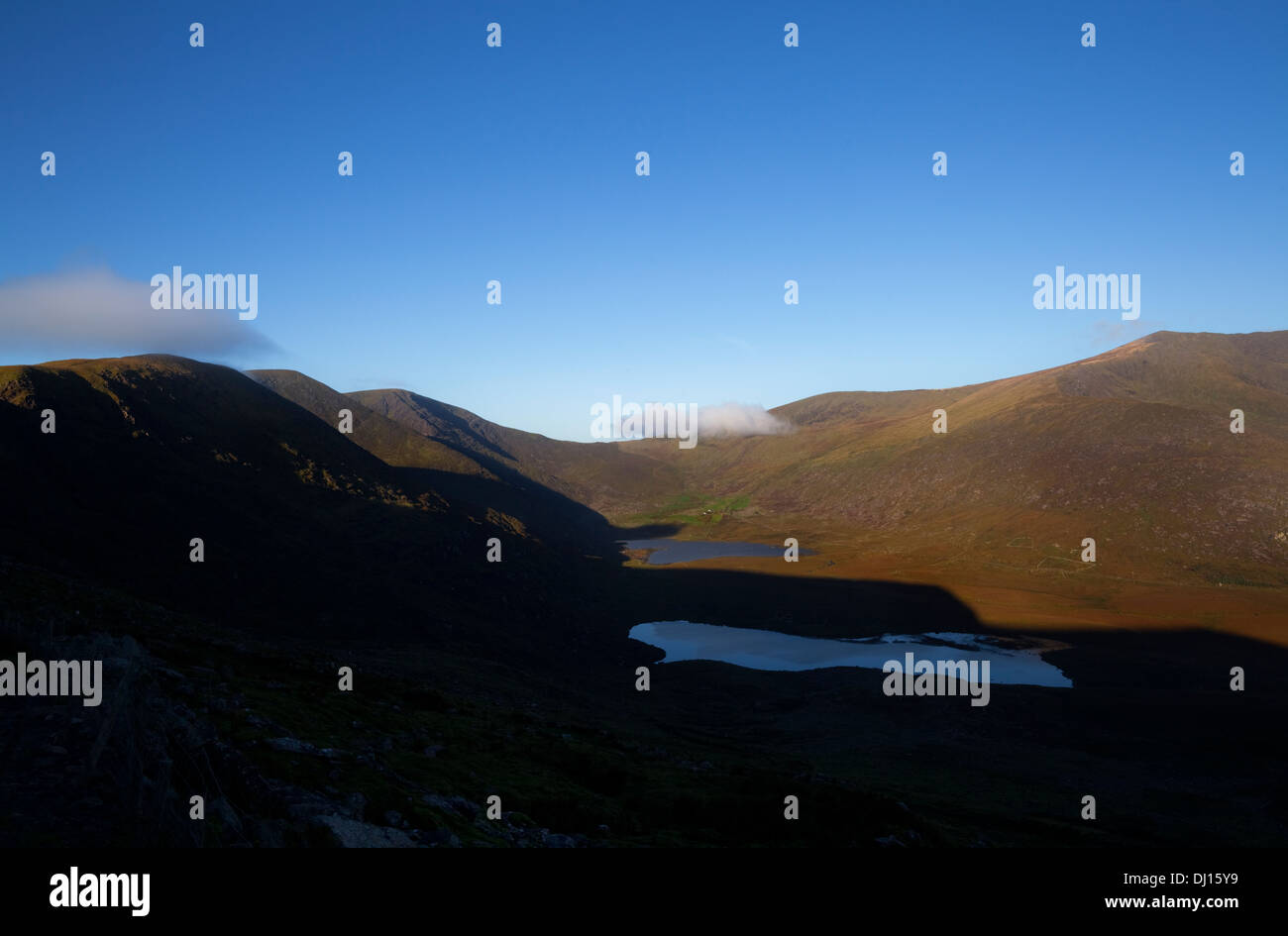 Lakes below the Conor Pass with Brandon Mountain, Dingle Peninsula, County Kerry, Ireland - Stock Image