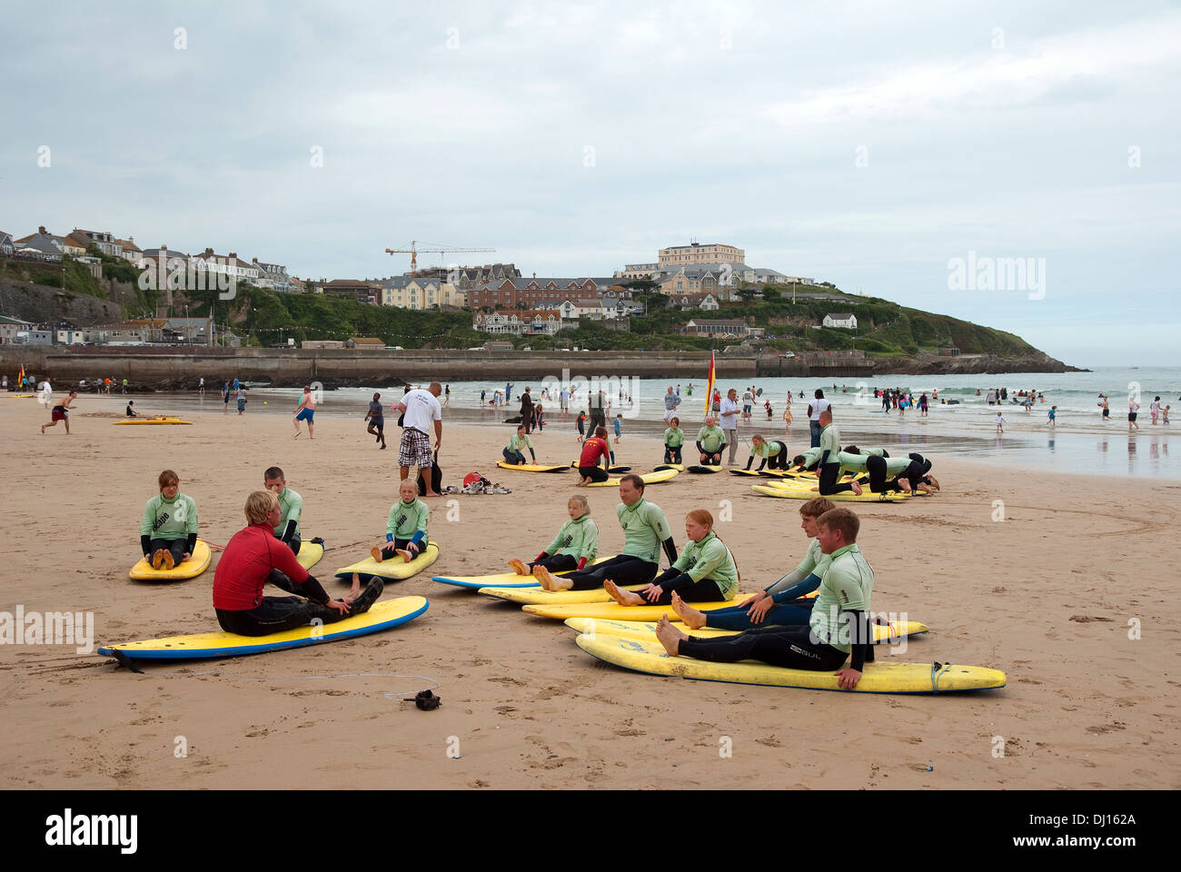 A ' surfing school ' on Towan beach in Newquay, Cornwall, UK - Stock Image