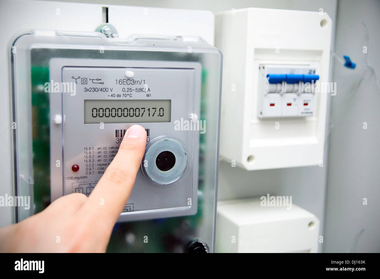 Modern electric meter close up view - Stock Image