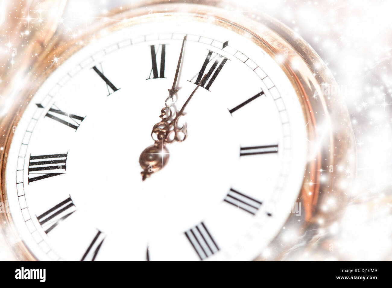 New Year\'s at midnight - Old golden clock with stars and snowflakes ...