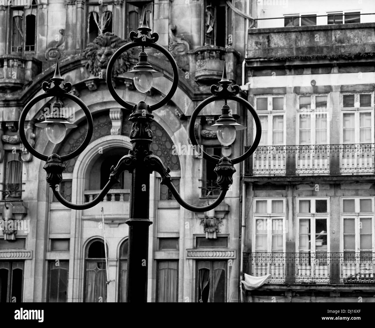 Portugal. Porto city. Ancient lantern opposite old house in black and white - Stock Image
