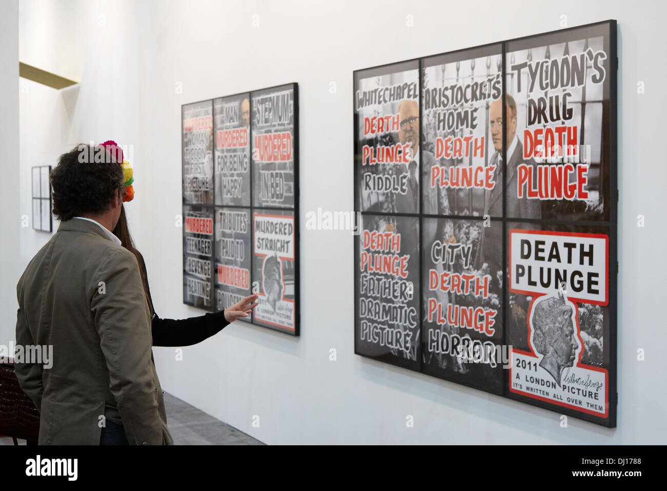 Gilbert & George artwork and visitors during Artissima 2013 art fair in Turin, Italy Stock Photo