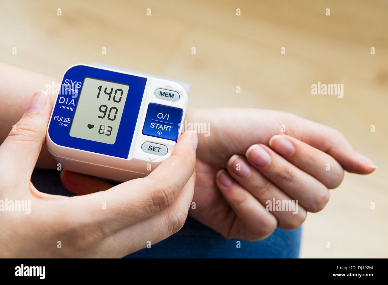 High blood pressure. woman measures the pressure - Stock Image