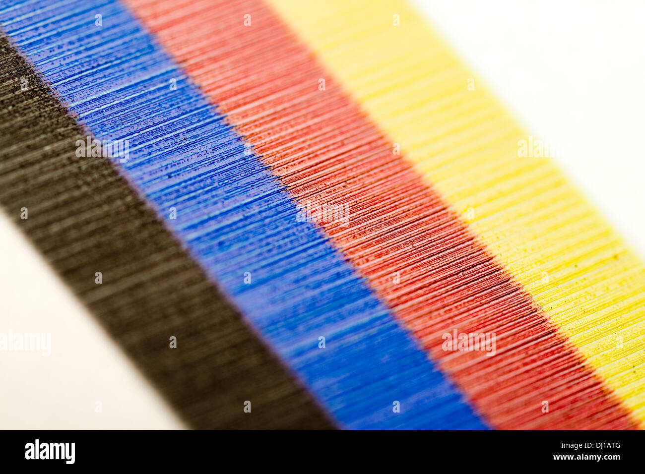 Extreme macro of a digital UV print, CMYK strips on the side of the print - Stock Image