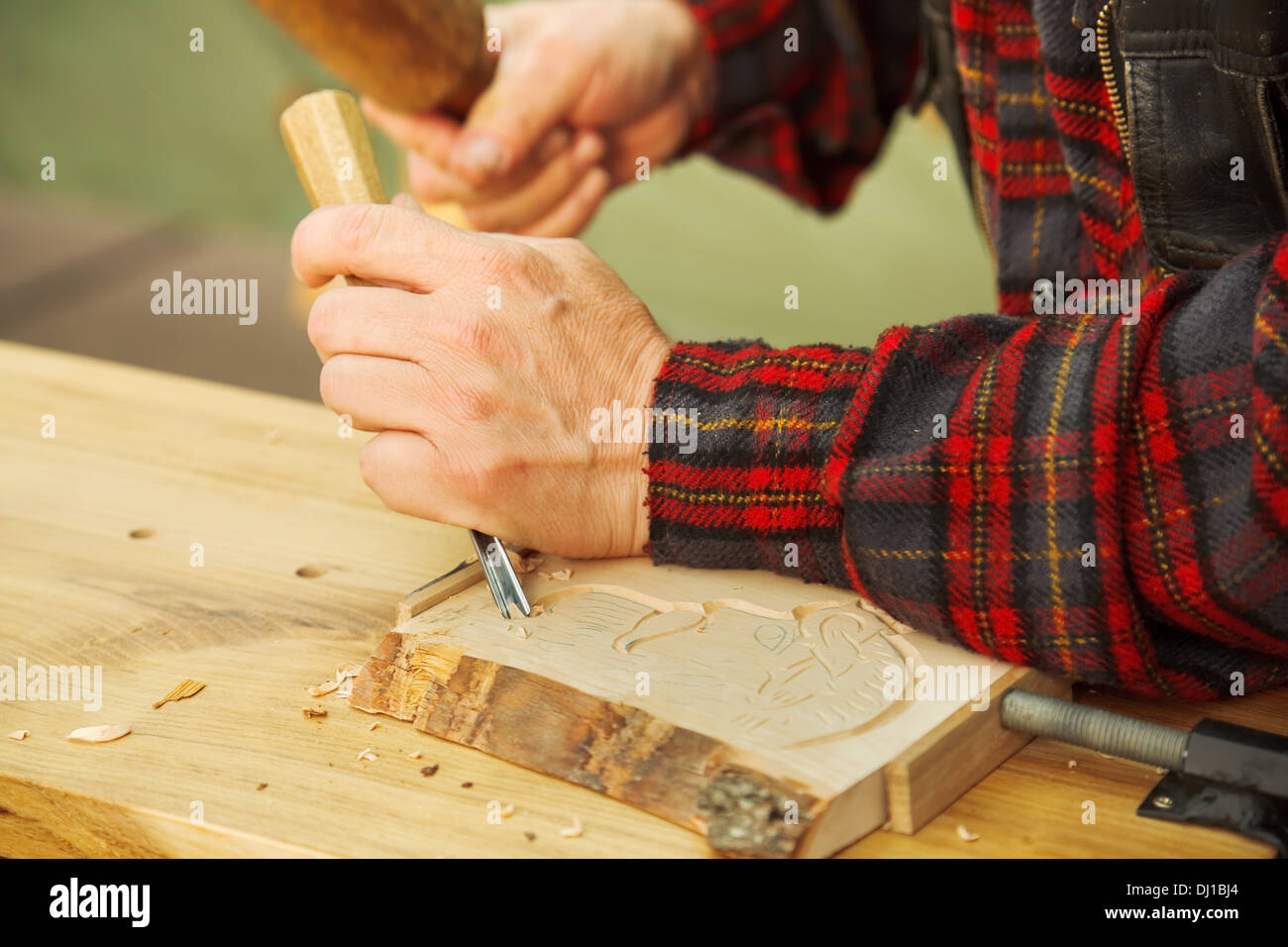 Popular art: wood carving by hand - Stock Image