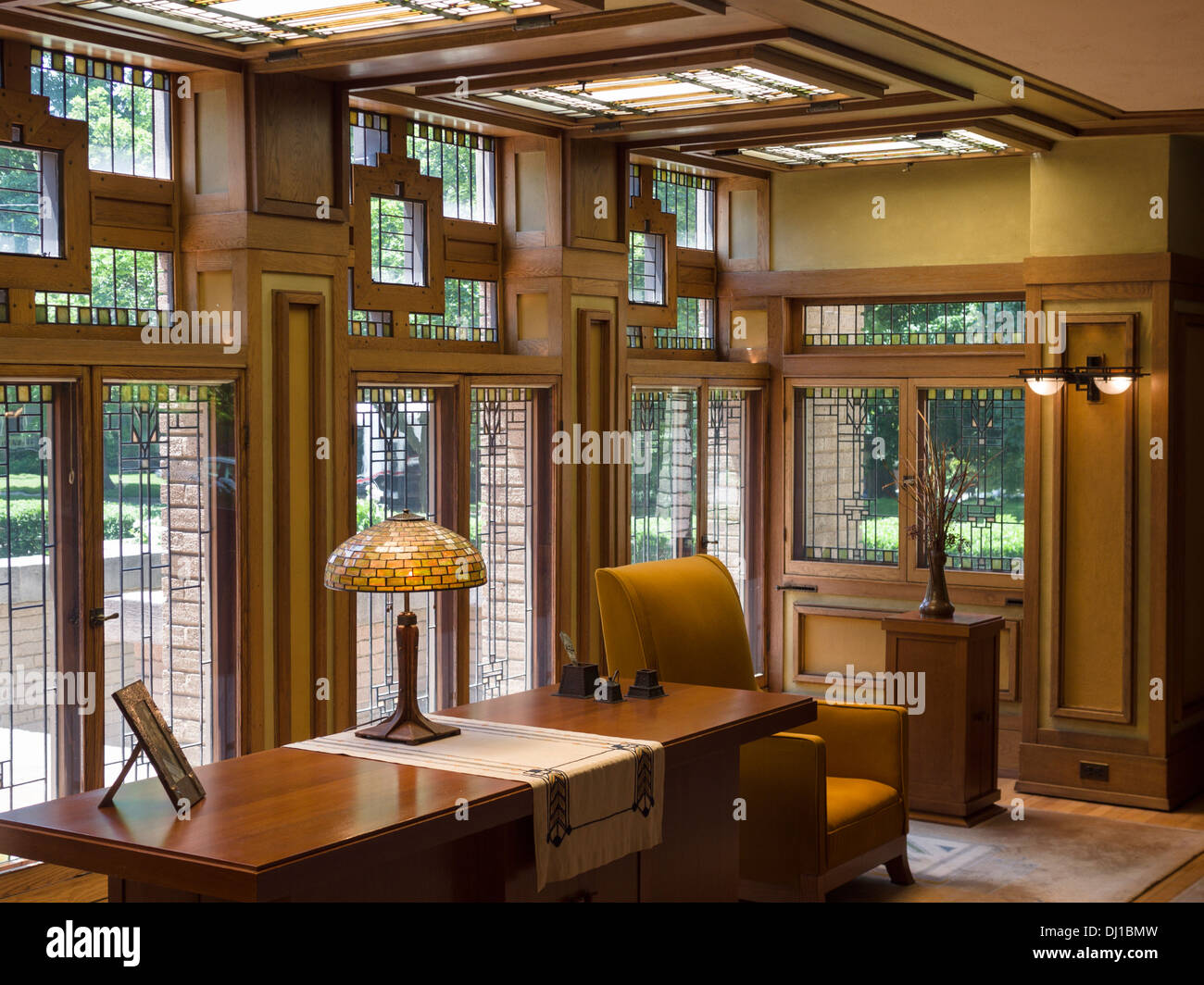 Light filled living room at Meyer May House. Windows, characteristic of FLW fill the ceiling and walls of the living room - Stock Image