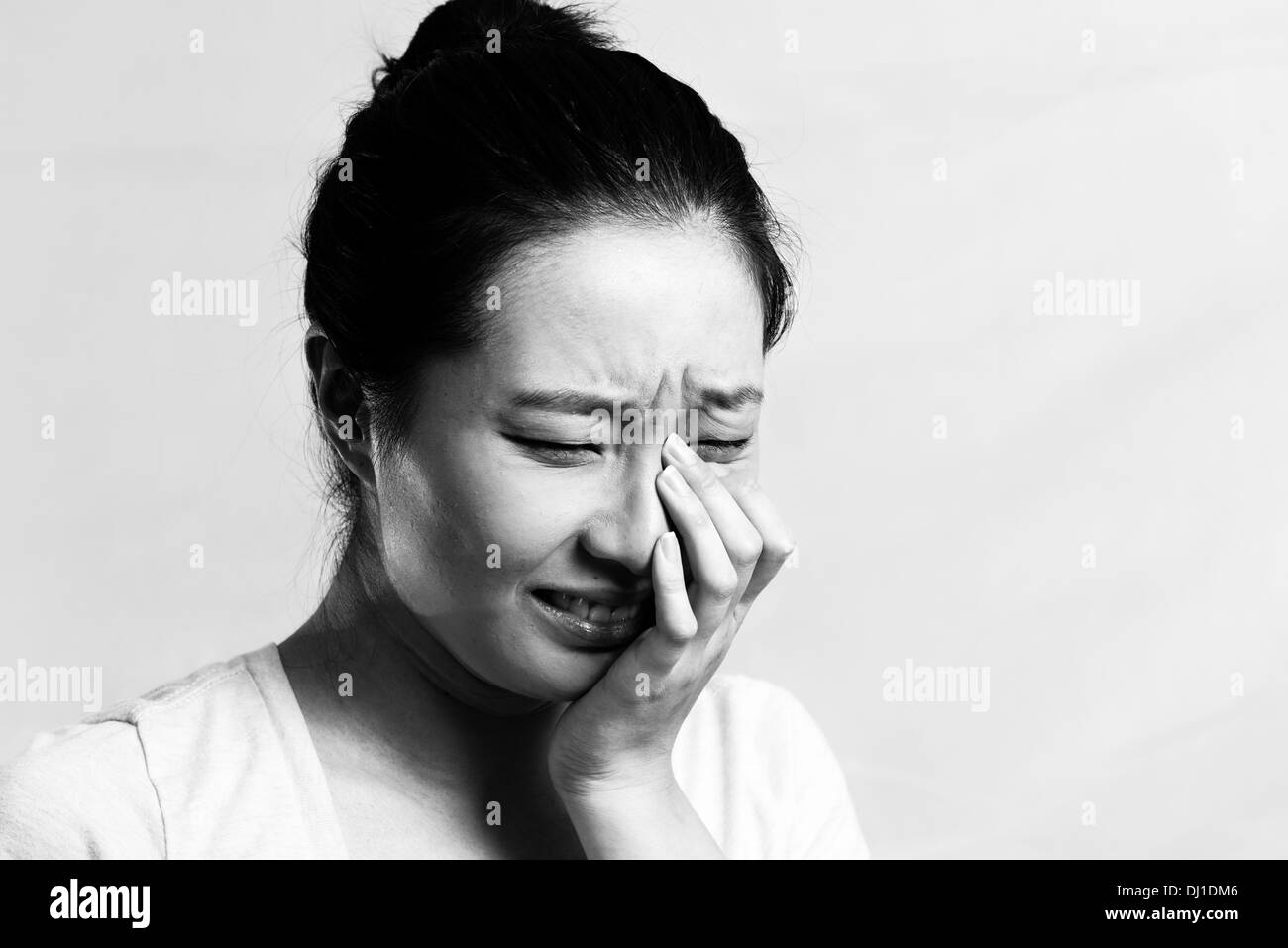 Portrait of pretty girl crying desperately black and white style