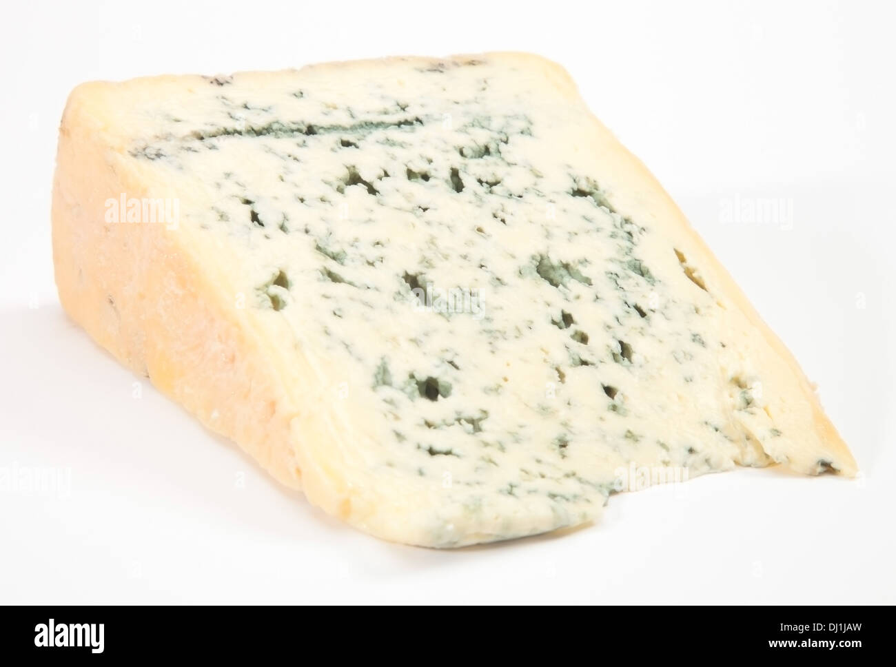 Wedge of full fat soft blue cheese - Stock Image