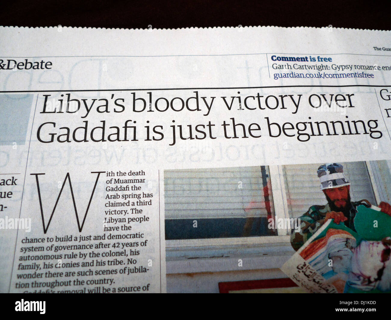 'Libya's bloody victory over Gaddafi is just the beginning' article on the death of Muammar Gaddafi - Stock Image