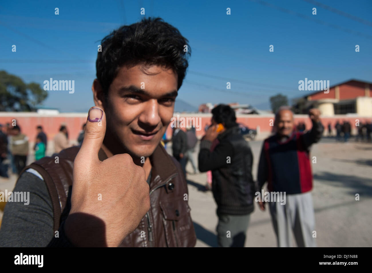 Nov. 19, 2013 - Kathmandu, Nepal - BIZIN UPADAYA, an 18 year old, shows marked finger after voting. He voted for the first time. Over 12 million eligible voters flocked to polling stations in a bid to elect the Constituent Assembly. The last elections were held in 2008 when the Constituent Assembly failed to write a new constitution. Nepal has been struggling with political uncertainty since 2006 when street demonstrations forced then King Gyanendra to give up his authoritarian rule. The Constituent Assembly elected in 2008 abolished the centuries-old monarchy and converted the nation to a rep - Stock Image