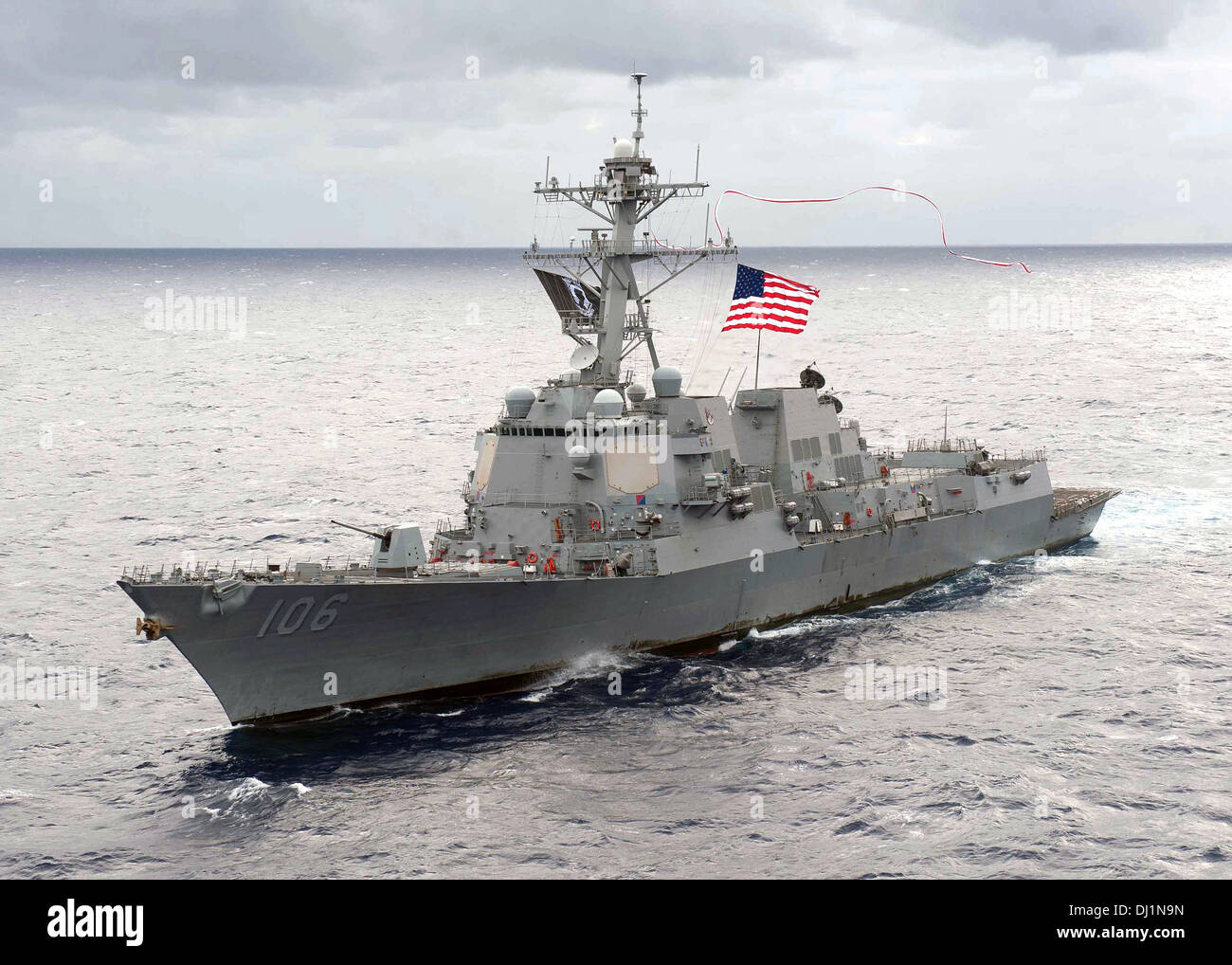 US Navy Arleigh Burke-class guided-missile destroyer USS Stockdale hoists a 240-foot homeward bound pennant as it - Stock Image