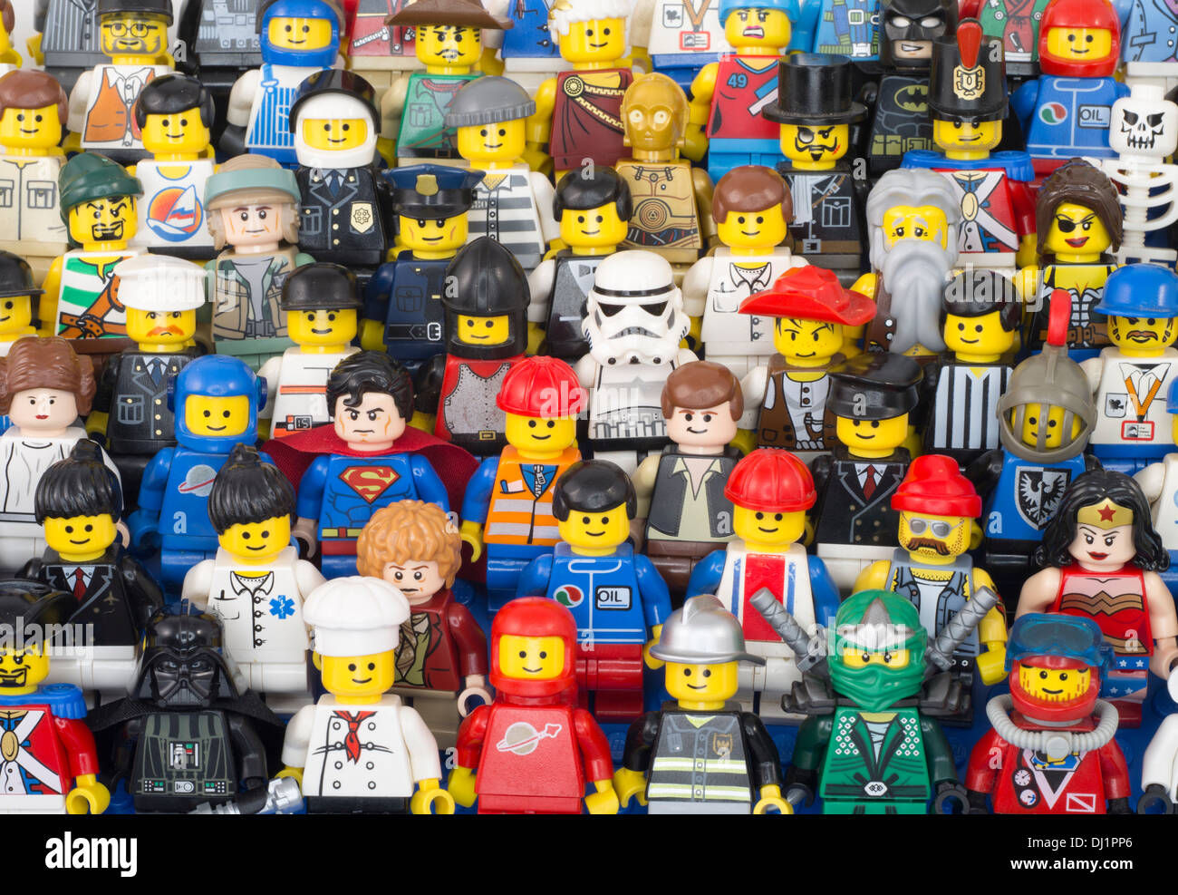 LEGO minifigures both classic and modern versions from early 80's spaceman to Stormtroopers and a Hobbit. - Stock Image