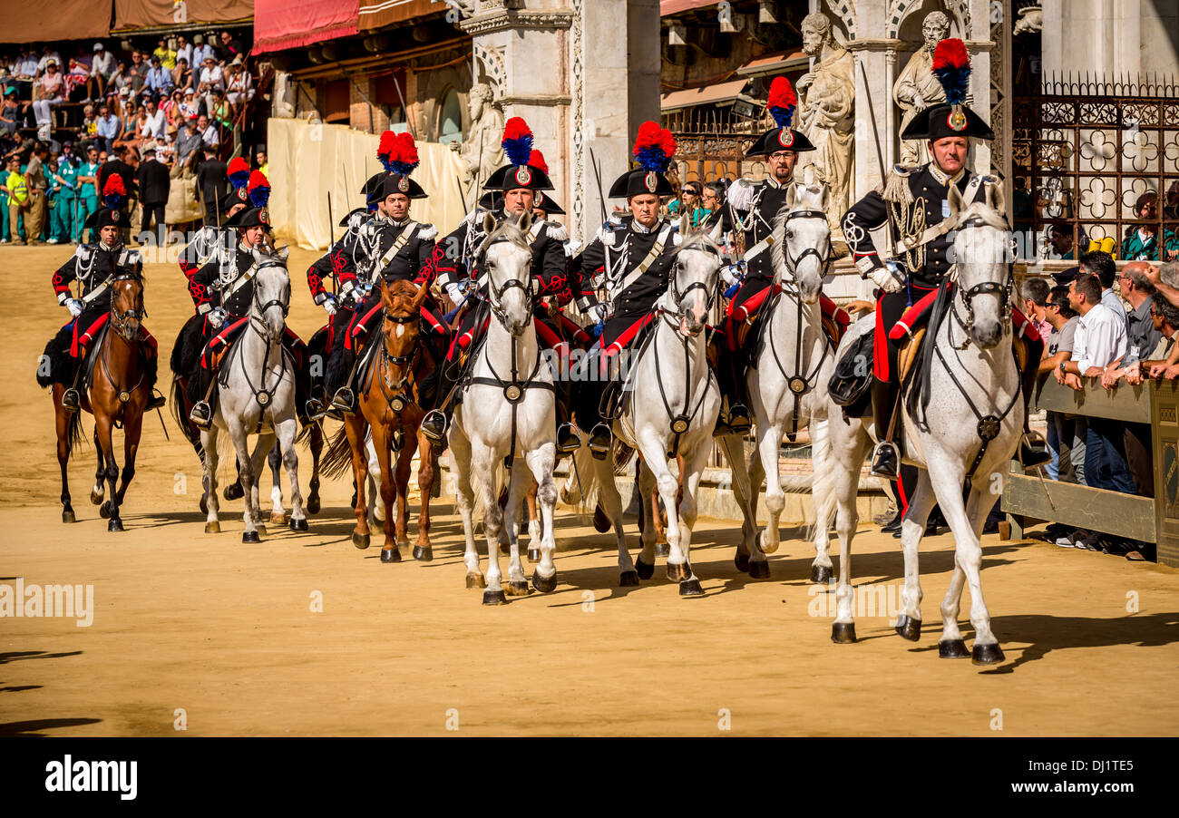 The riding Italian police - Carabinieri, The Palio, Piazza del Campo, Siena, Italy - Stock Image