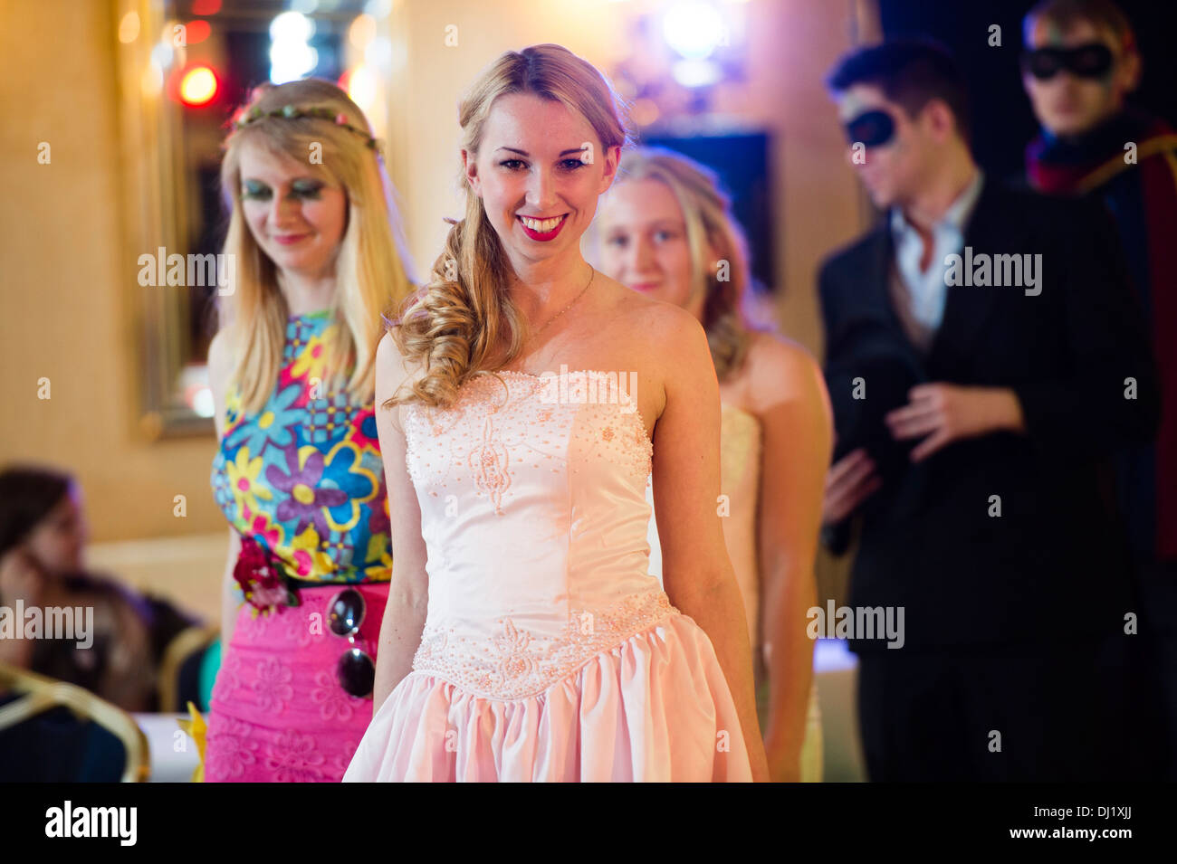 Amateur models on the catwalk at a charity fashion show in aid of Leukaemia Care. - Stock Image