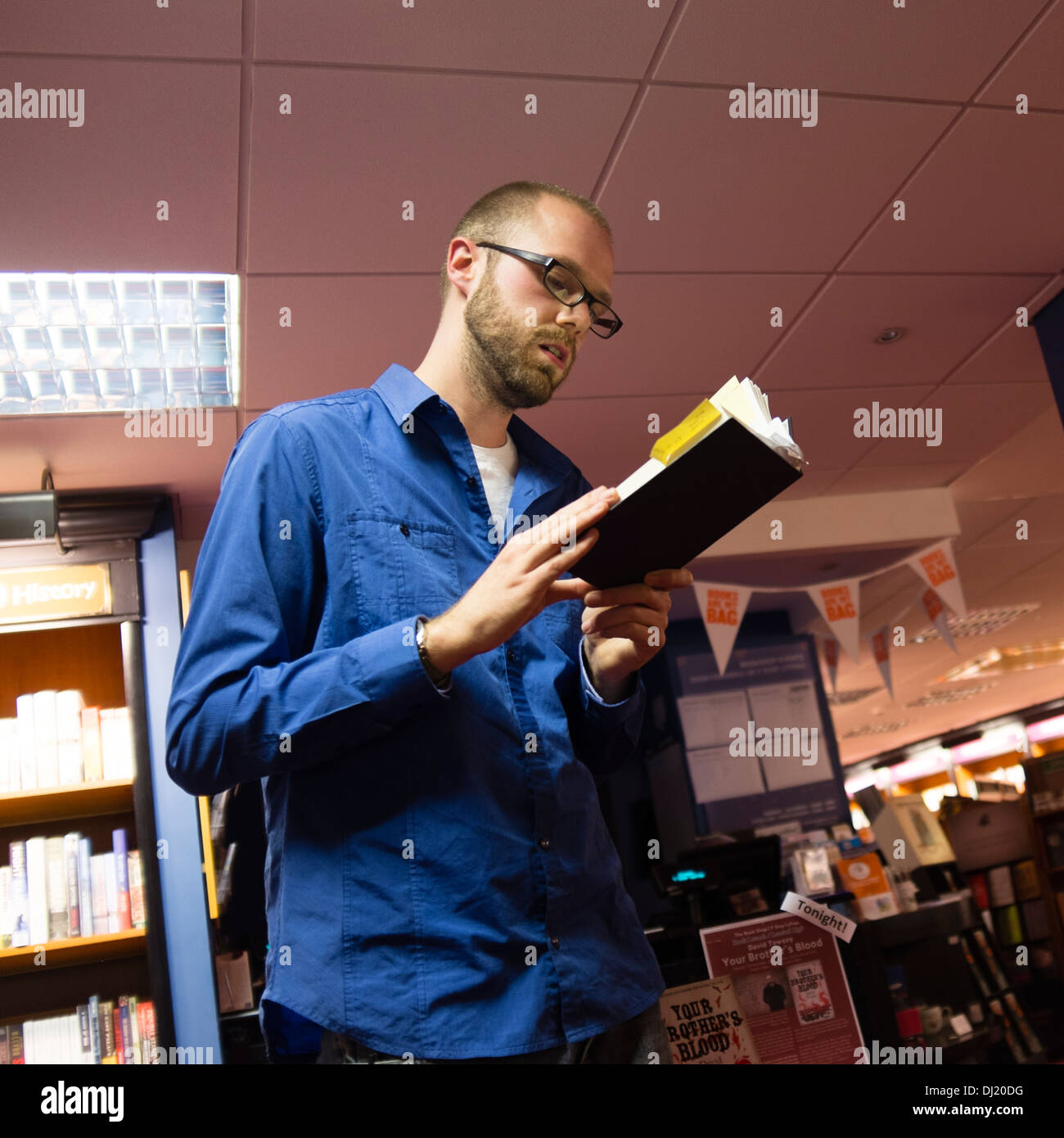 DAVE TOWSEY, reading from his novel 'His Brother's Blood' at Aberystwyth Arts Centre bookshop, November 7 2013 - Stock Image