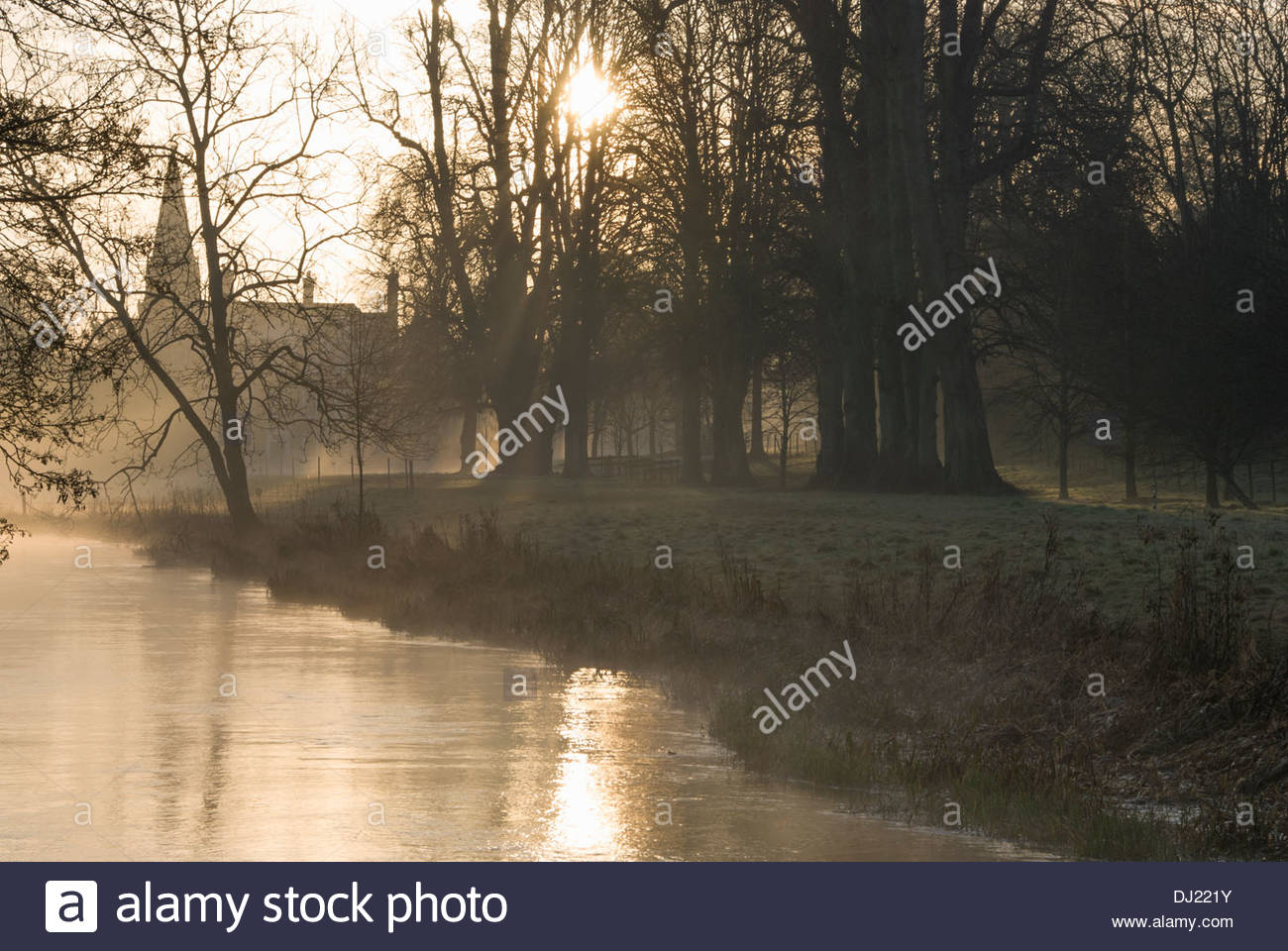 Mist rises from the River Lambourn as it runs through the grounds of Welford Park, Newbury, Berks, UK Stock Photo