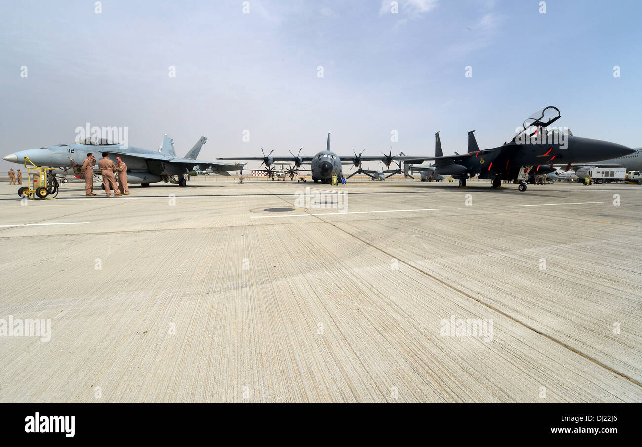 The C-130J Hercules sits centrally between an F-18 Hornet and an F-15E Strike Eagle during the 2013 Dubai Airshow Stock Photo