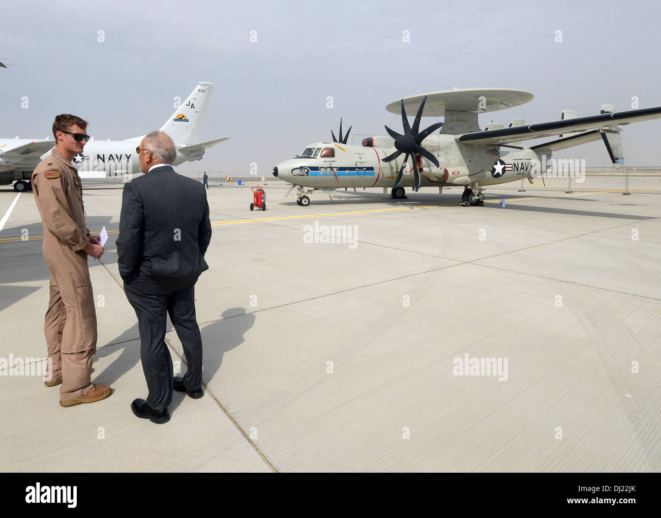 U.S. Navy Lt. Mike Lane talks to a spectator about the E-2 Hawkeye during the 2013 Dubai Airshow at the Dubai World Central airport in Jebel Ali, United Arab Emirates, Nov. 17, 2013. The U.S. participates in the DAS, one of the largest airshows in the wor - Stock Image