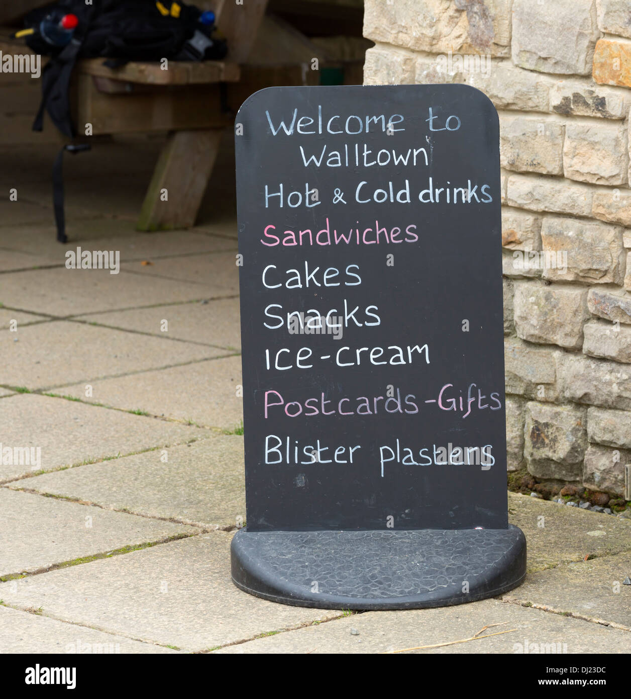 Chalkboard outside the cafe at Walltown. The board advertises usual cafe fare, and blister plasters for walkers with sore feet. - Stock Image