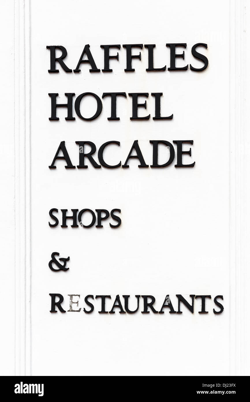 Raffles hotel arcade shops and Restaurant sign, Singapore - Stock Image