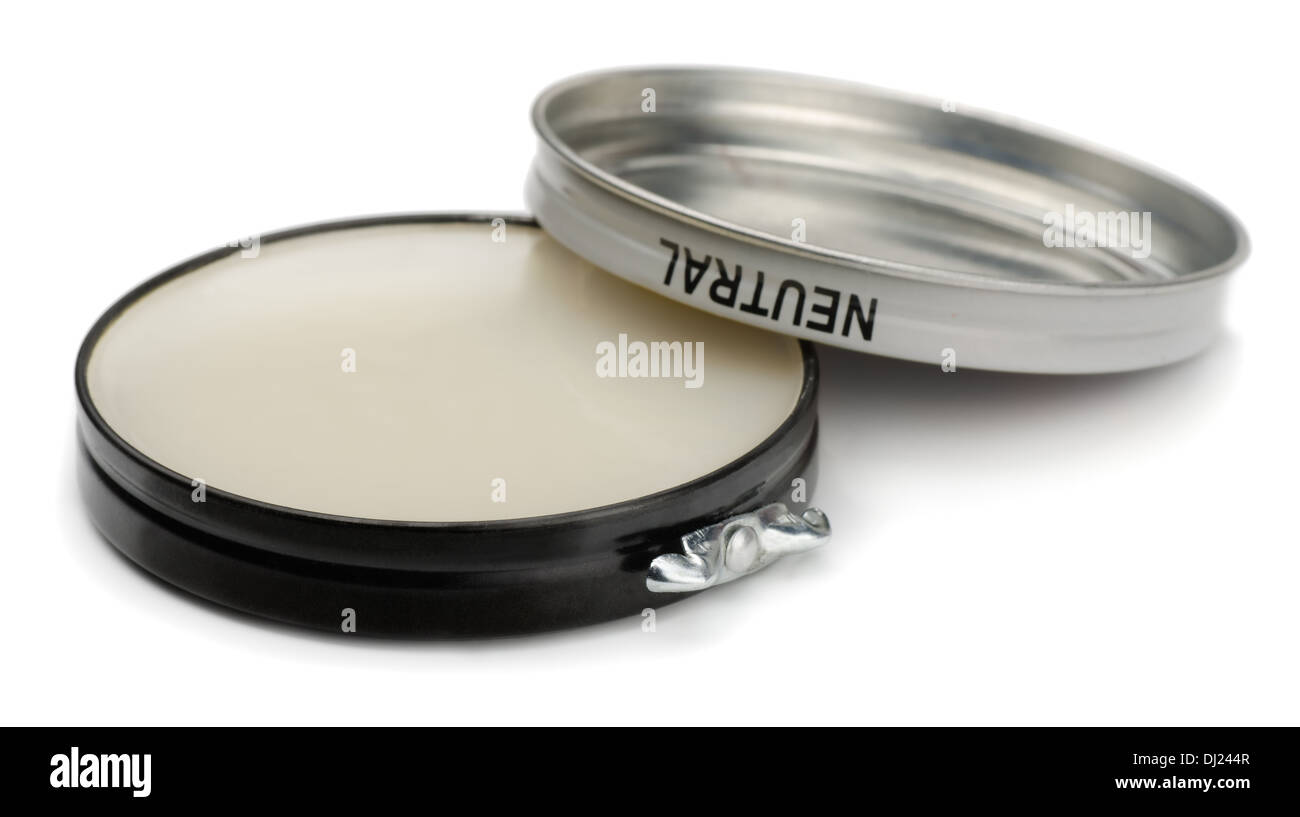 Tin of neutral shoe polish isolated on white - Stock Image