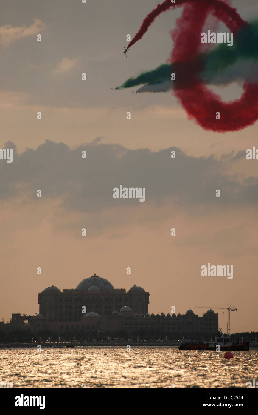 The Al Fursan aerial display team of the UAE Air Force perform on National Day in front of Emirates Palace Stock Photo