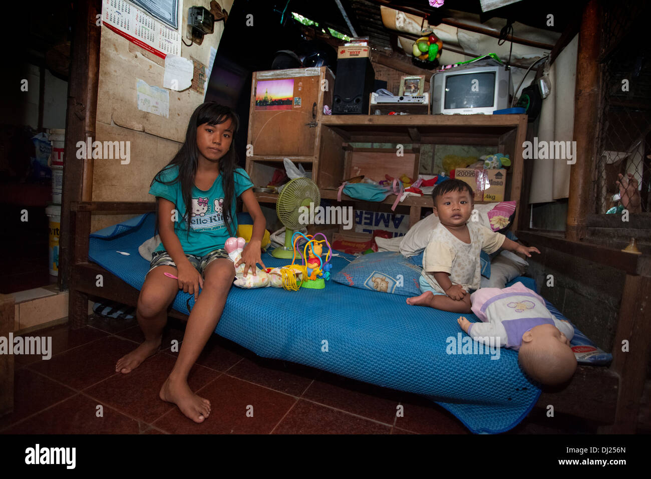 Children Disfigured family crippled poor Bali poverty challenged extreme poor bellow standard Indonesia 29 house conditions hars - Stock Image