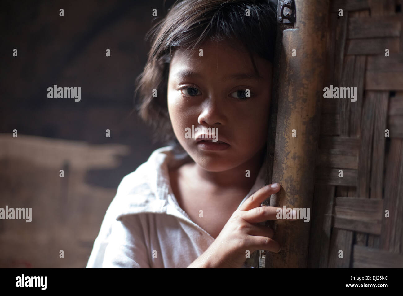 girl child poor bali poverty sad challenged extreme hold feed poor