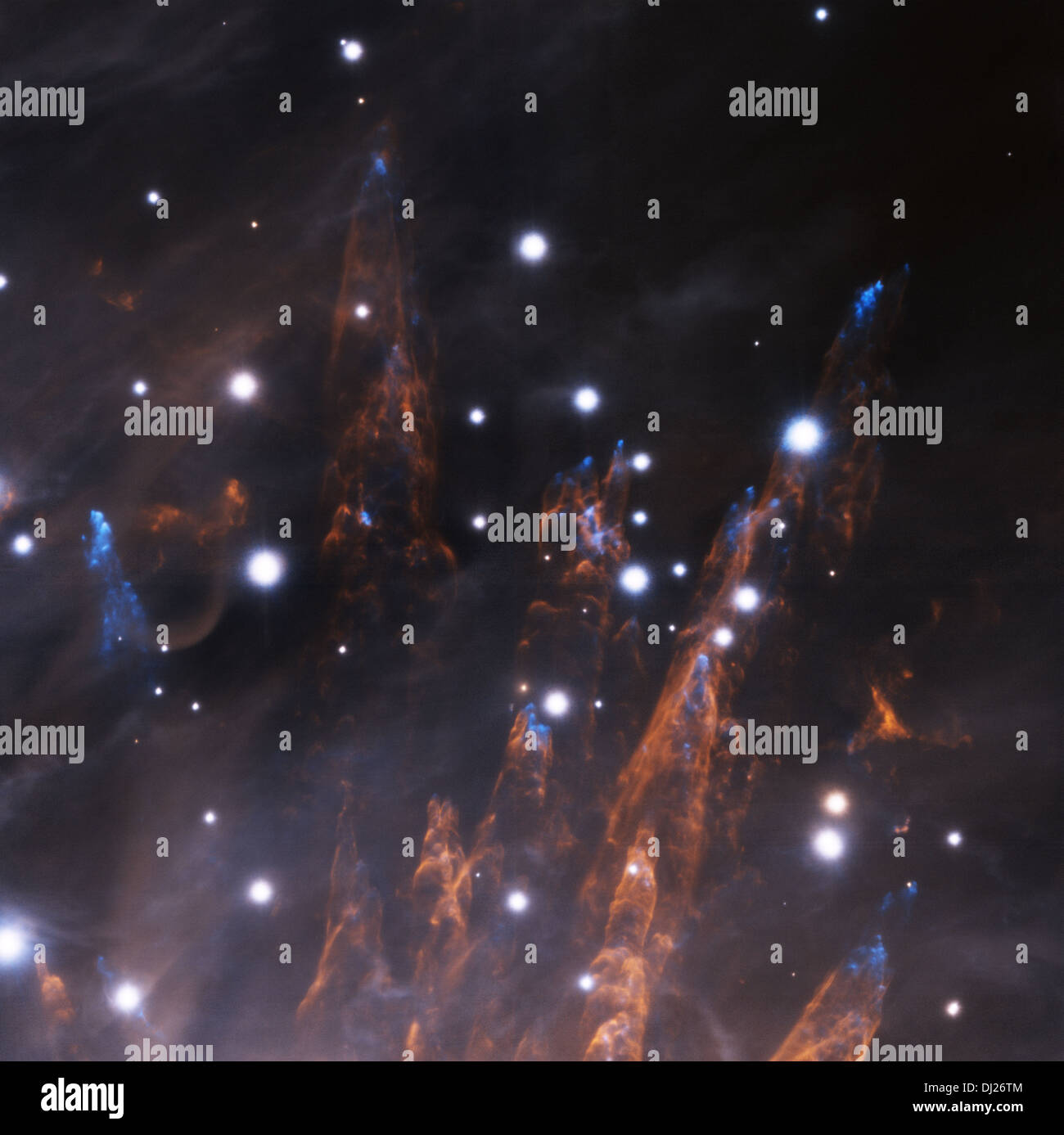 Cosmic bullets pierce the outskirts of the Orion Nebula some 1500 light-years distant in this sharp infrared close-up. - Stock Image