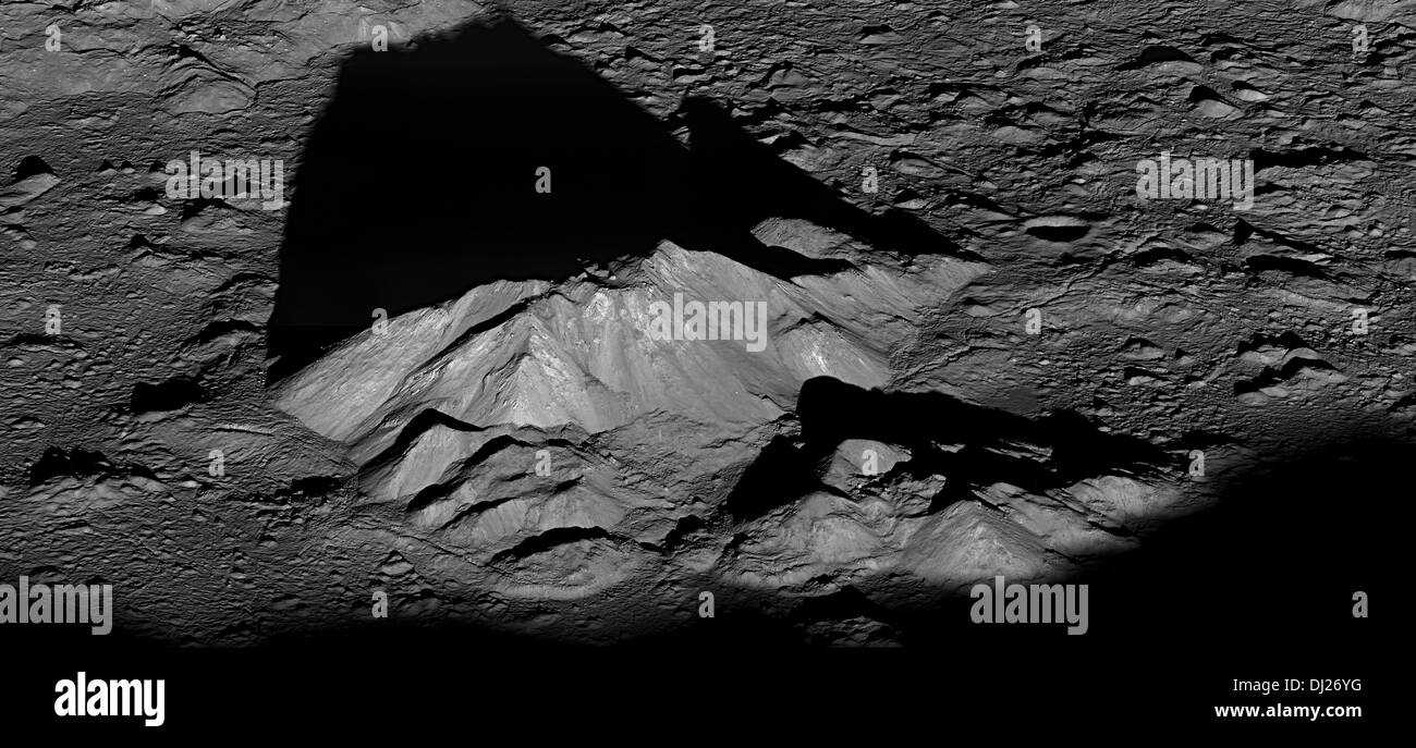 Tycho crater's central peak complex casts a long, dark shadow near local sunrise in this spectacular lunarscape. - Stock Image