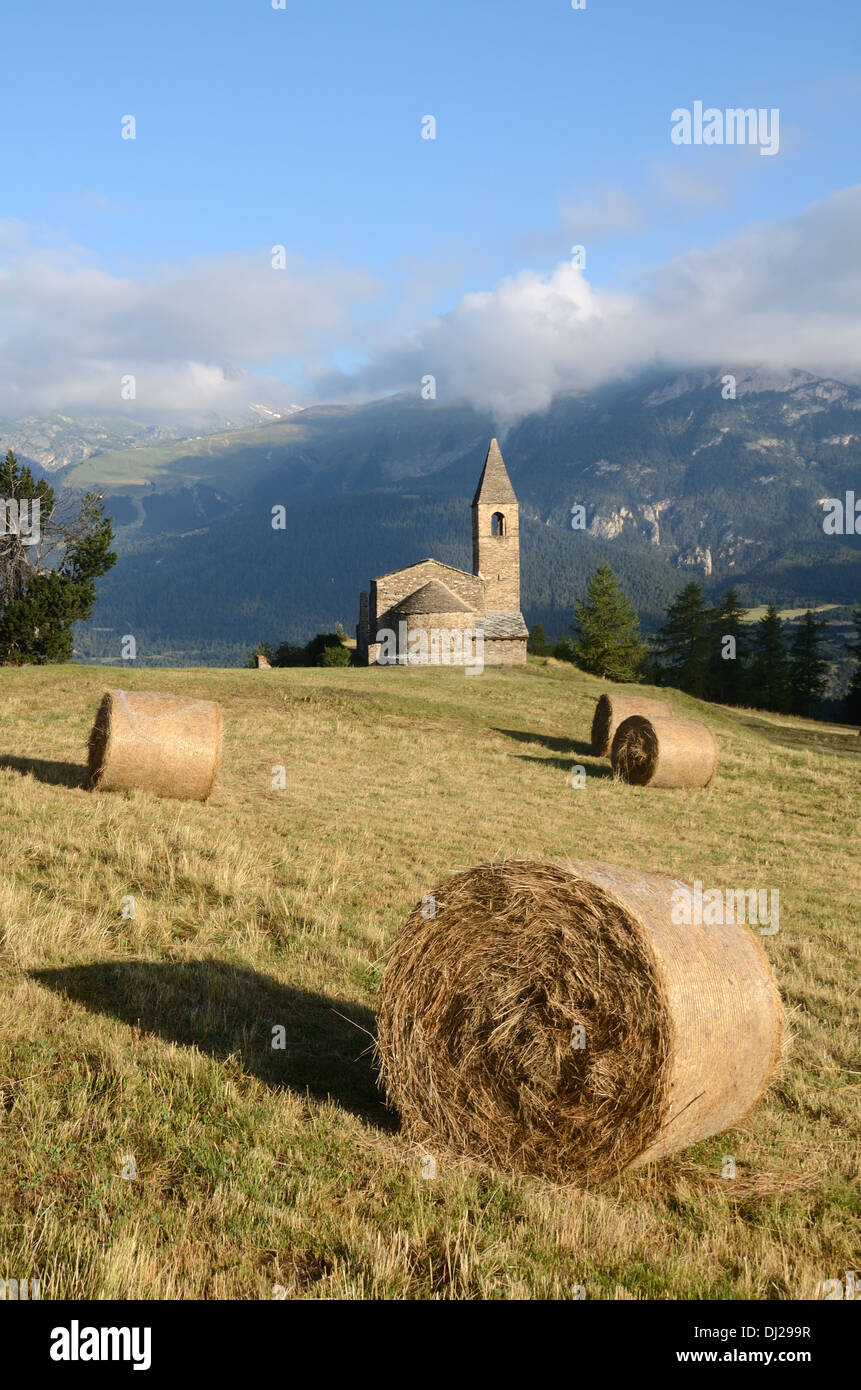 Church Chapel or Eglise St-Pierre d'Extravache and Vanoise National Park in Background French Alps Savoie France - Stock Image
