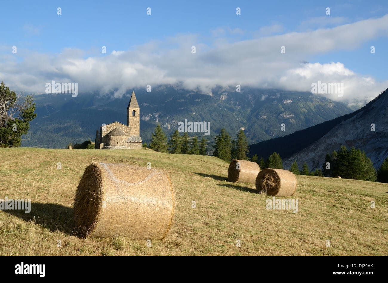 Hay Bales in front of Eglise St-Pierre Extravache & Vanoise National Park Bramans Haute Maurienne Savoie France - Stock Image