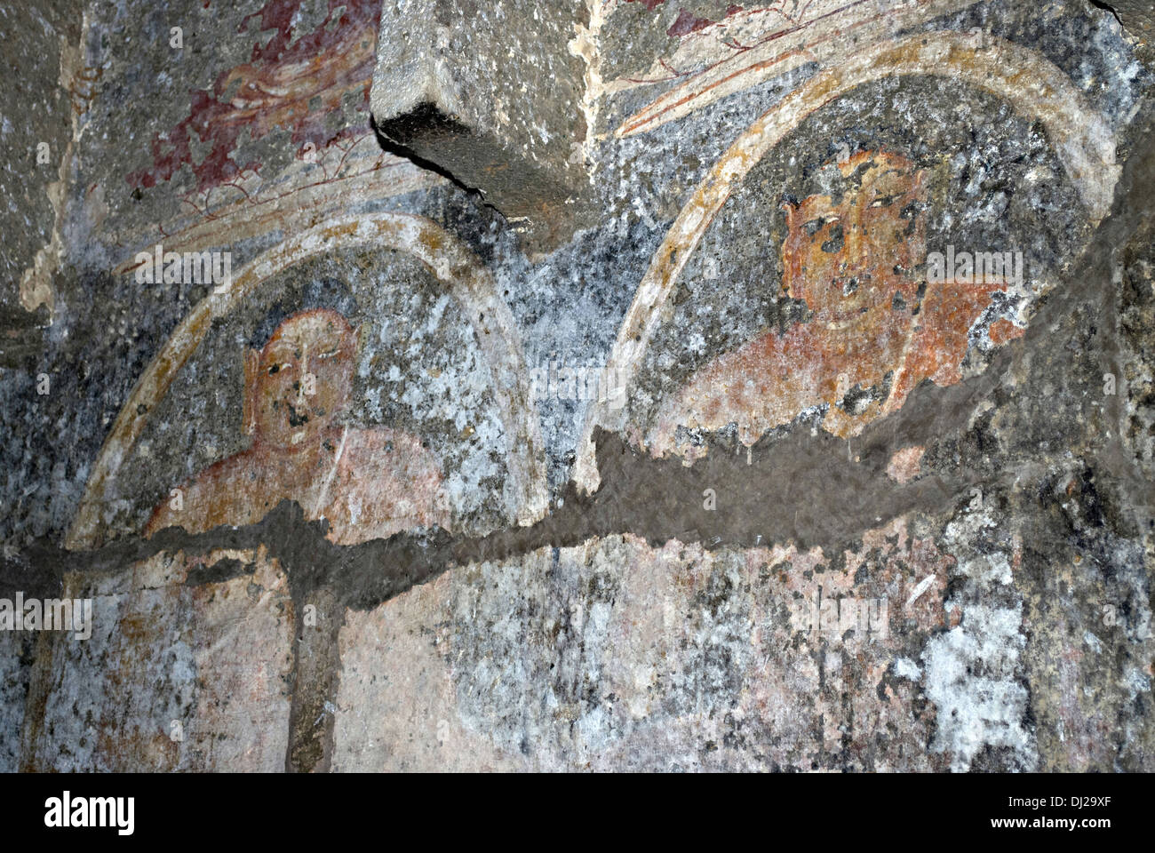 Pitalkhora Caves. Painted standing Buddhas of 5th. Century AD on left wall of Chaitya 3. Aurangabad district, Maharashtra, India - Stock Image