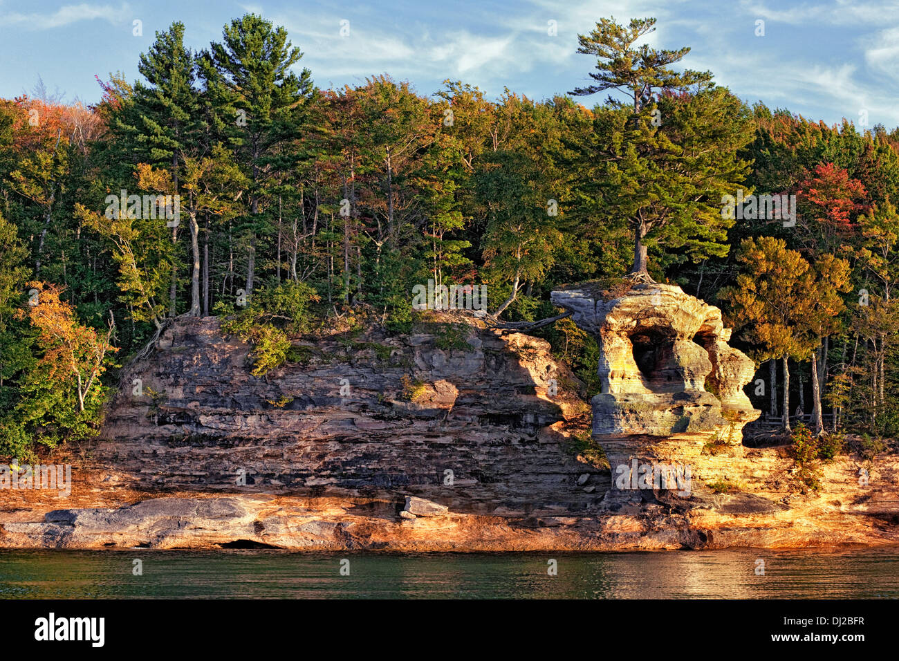 Large pine tree grows atop Chapel Rock along Lake Superior in Pictured Rocks National Lakeshore and Michigan's Upper Stock Photo