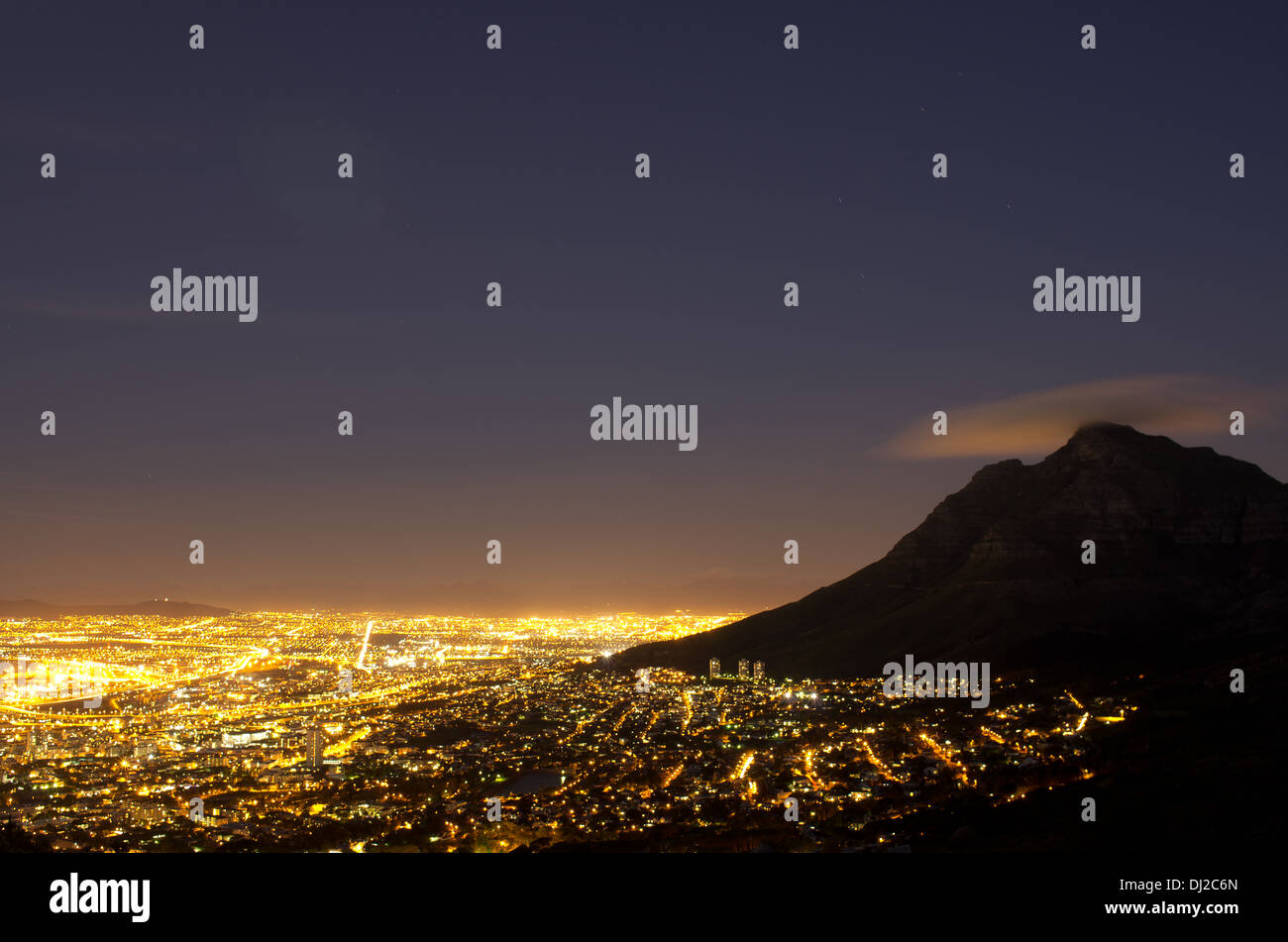 Nightscape of Cape Town, South Africa. View is from Lion's Head, overlooking Devil's Peak. - Stock Image
