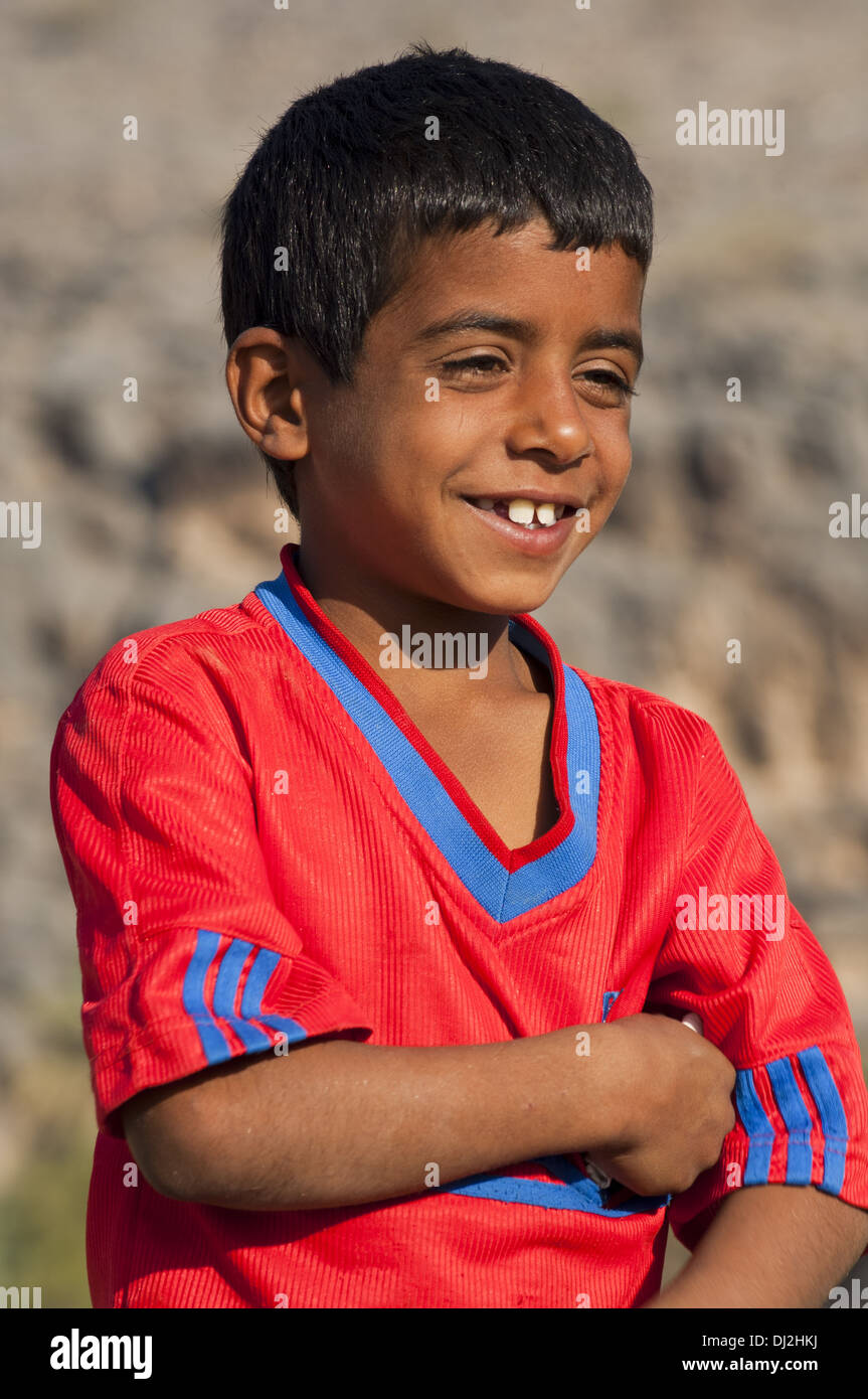Portrait of a laughing 7-year old Omani boy - Stock Image