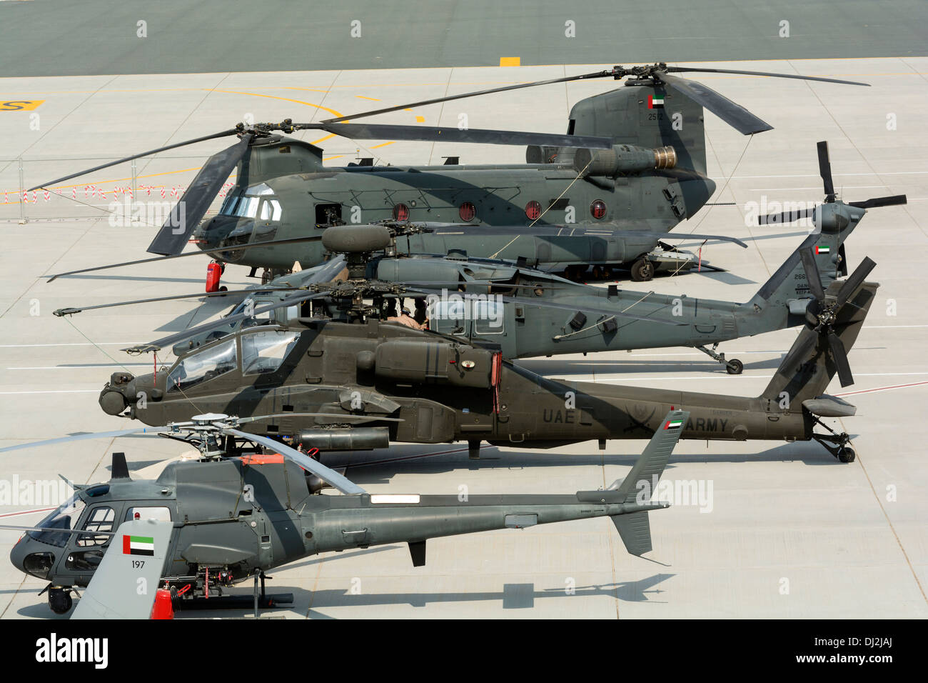 Military helicopters on apron at Al Maktoum International airport during Dubai Airshow 2013 in United Arab Emirates Stock Photo