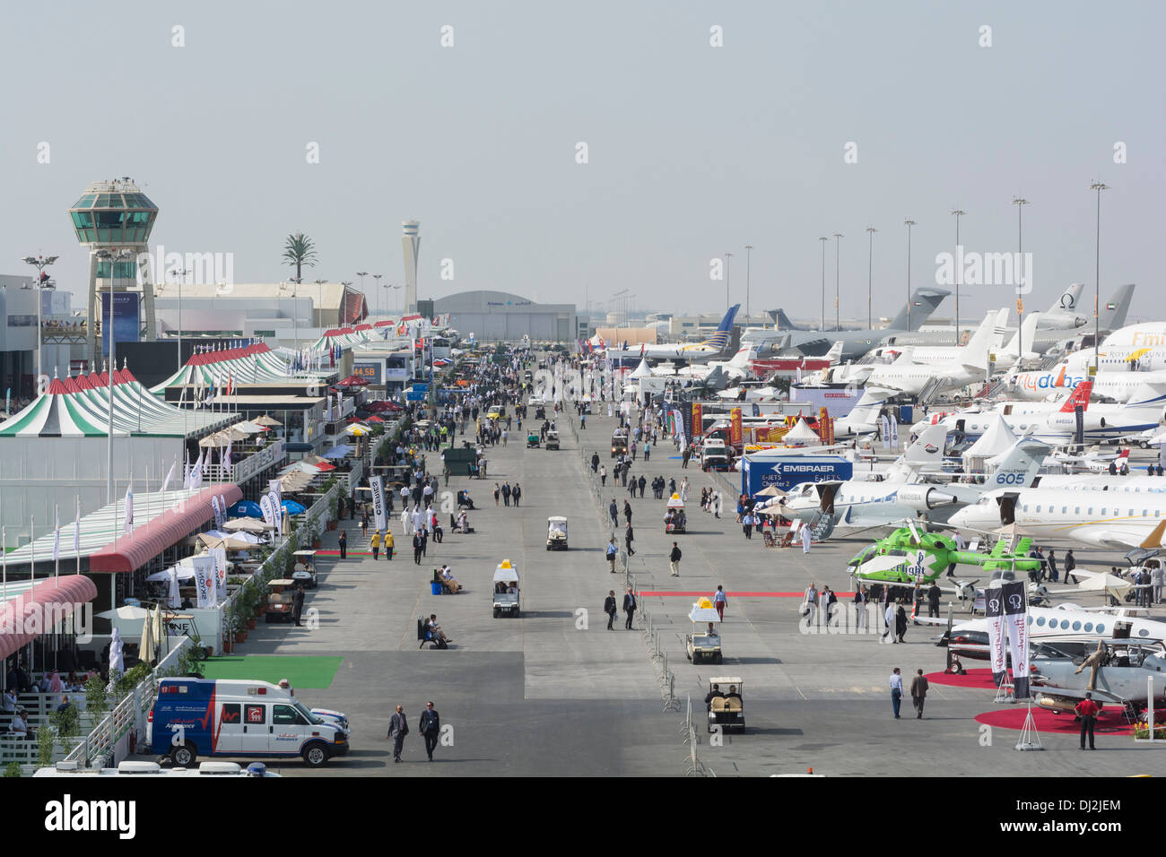 Many aircraft on apron at Al Maktoum International airport during Dubai Airshow 2013 in United Arab Emirates - Stock Image