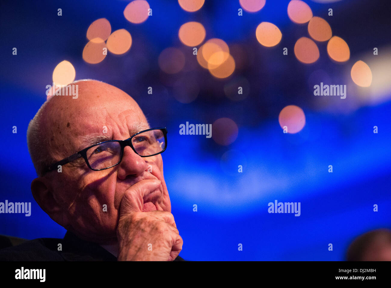 Washington, DC. 19th Nov, 2013. Rupert Murdoch listens to United States President Barack Obama make remarks at the Wall Street Journal CEO Council annual meeting, at the Four Seasons Hotel, on November 19, 2013, in Washington, DC. Obama discussed immigration reform and the health care rollout, among other topics. Credit: Drew Angerer / Pool via CNP/dpa/Alamy Live News - Stock Image