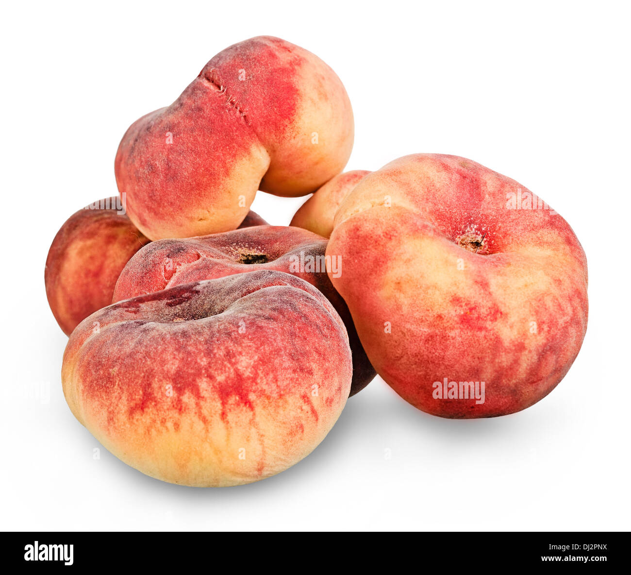 Donut peaches over white background . Images collected from four shots to increase the zone of sharpness - Stock Image