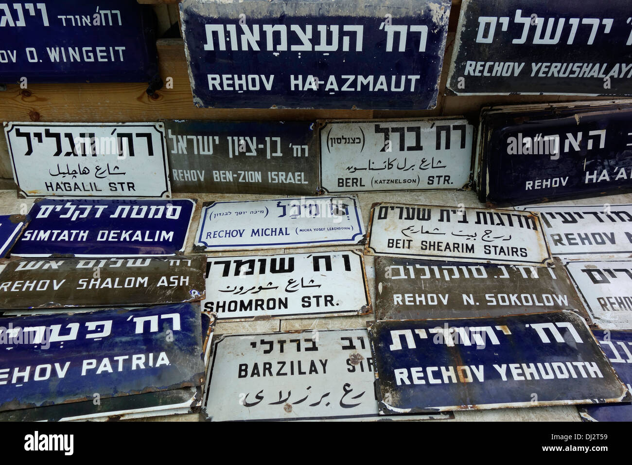 Collection of old street name signs for sale in the flea market of Jaffa in Israel - Stock Image