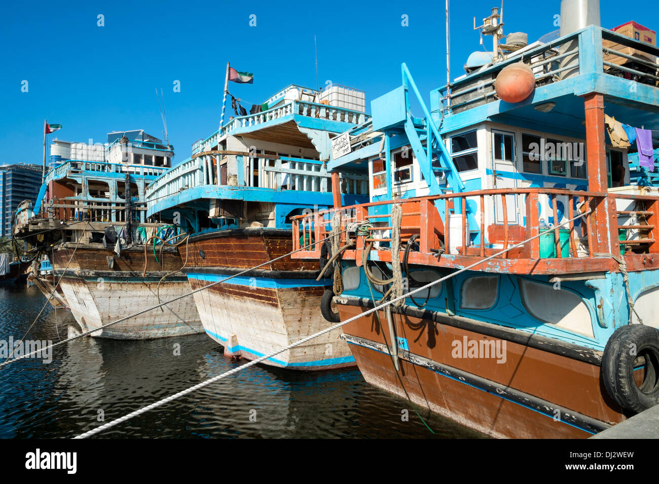 Traditional cargo dhows at cargo wharf on The Creek in Dubai United Arab Emirates - Stock Image