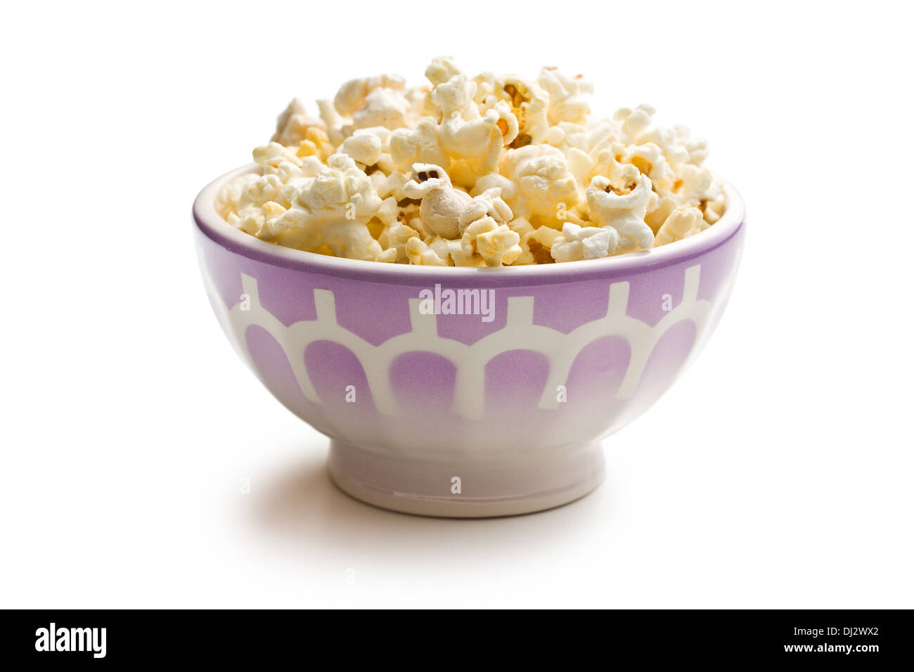 popcorn in ceramic bowl on white background - Stock Image